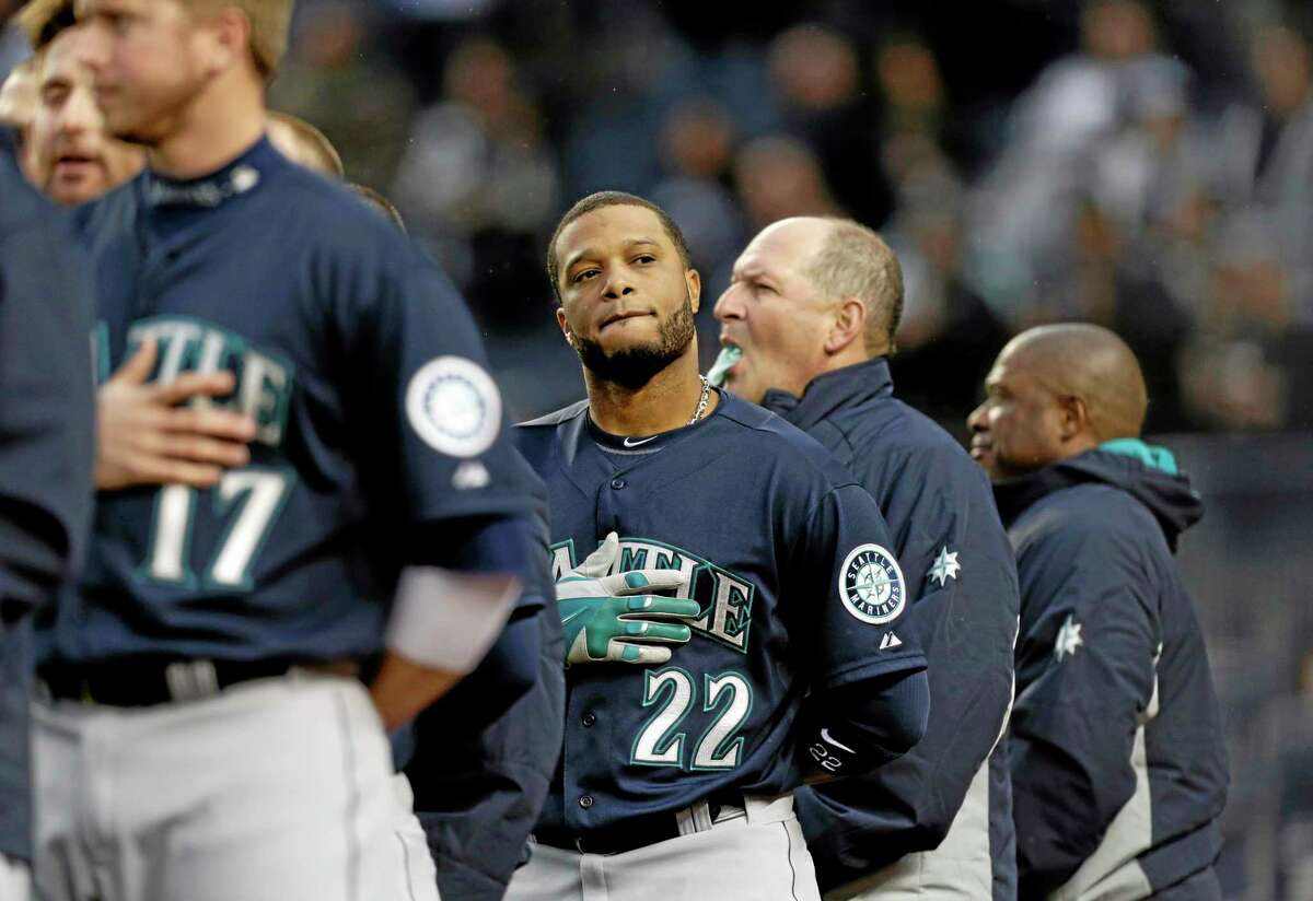 The Mariners' Robinson Cano looks in the stands during the playing of the national anthem before Tuesday's game against the Yankees.