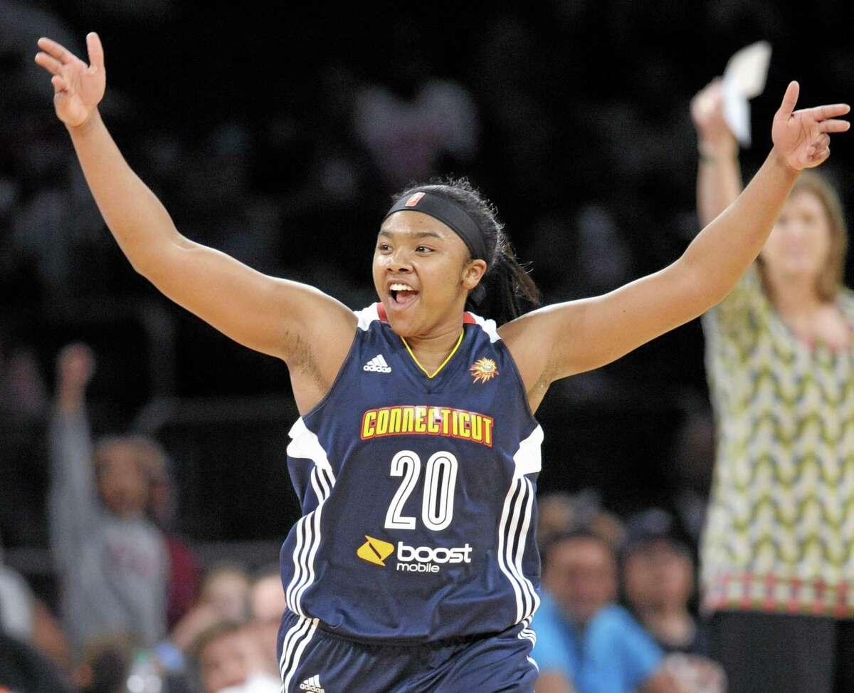 Connecticut Sun guard Alex Bentley celebrates during the fourth quarter of a WNBA basketball game against the Ne York Liberty, Friday, June 13, 2014, at Madison Square Garden in New York. The Sun won 85-73. (AP Photo/Bill Kostroun)