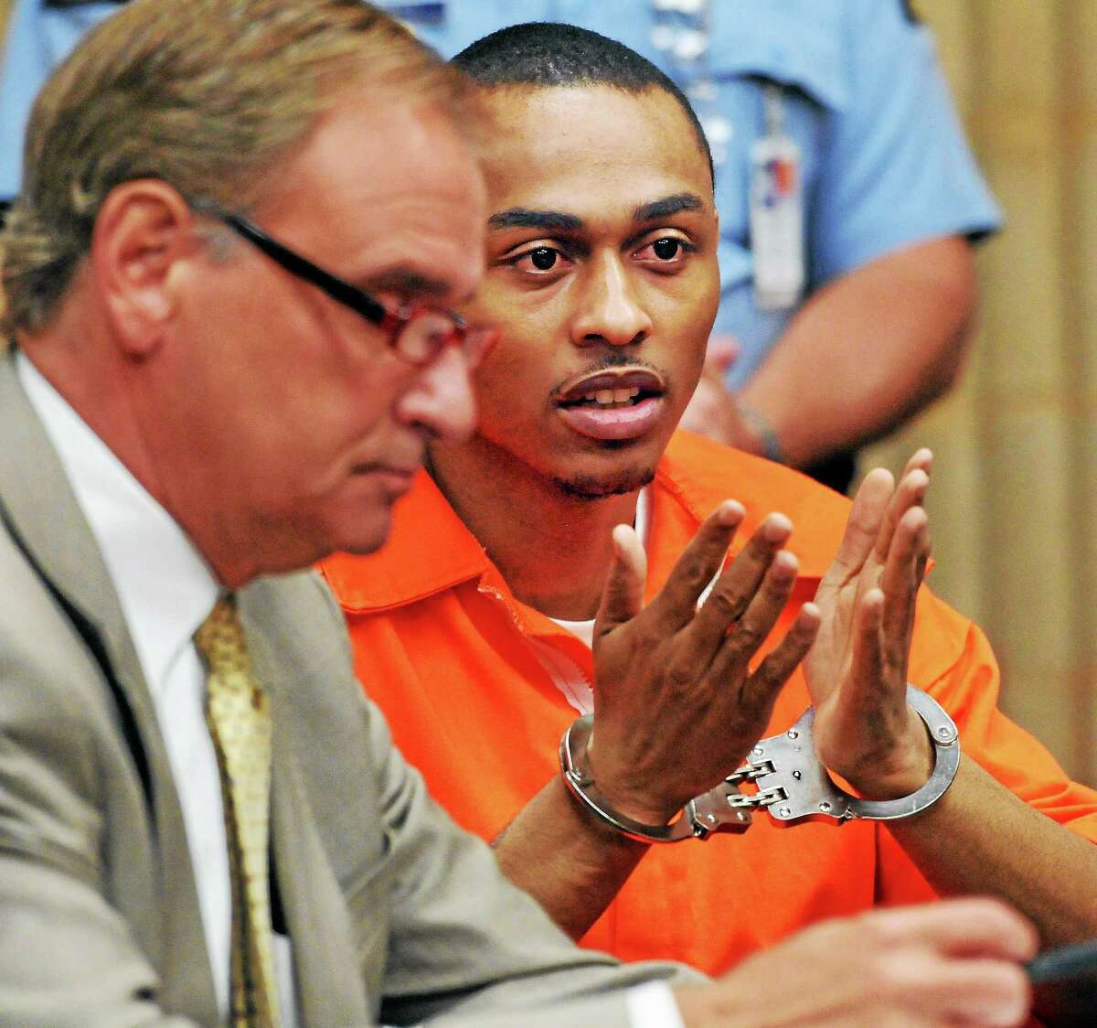 Cordaryl Silva with his lawyer Lawrence S. Hopkins, addresses the judge before sentencing.