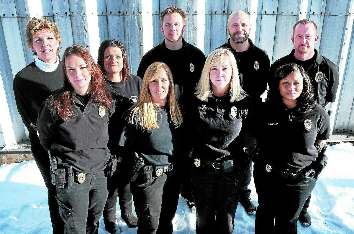 From left, Michelene Longo, correctional substance abuse counselor; Parole Officer Trudy Beaulieu; secretary Suzanne Kiniry; Parole Officer Dawn Rizzuto; Parole Officer Alan Piascik; Parole Manager Jennifer Bennett; Parole Officer Dave Skarzynski; Parole Officer Lushonda Howard; and Parole Officer Art Reardon of the Department of Correction's DUI Unit are photographed at the Maloney Center for Training and Staff Development in Cheshire.