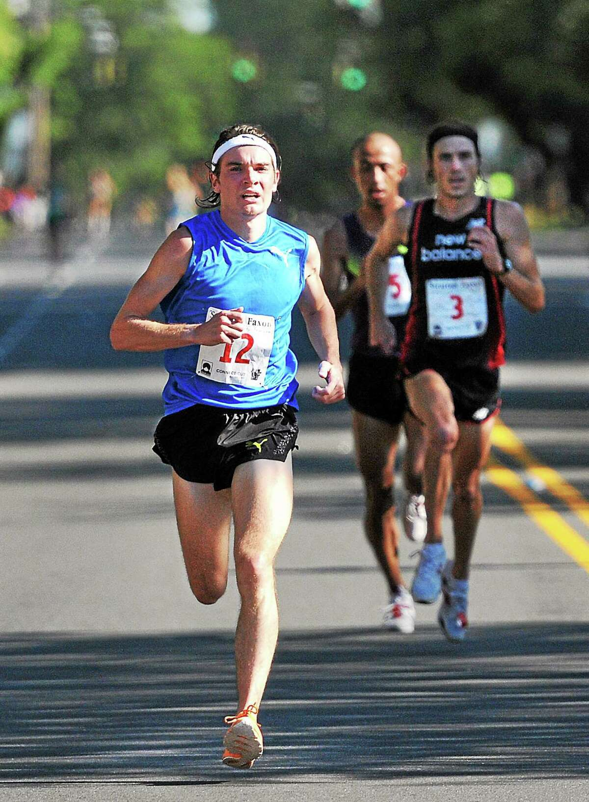 Sean Quigley starts to increase his lead over James Carney and Mohamed Trafeh along Whitney Avenue on his way to winning the 2010 New Haven Road Race.