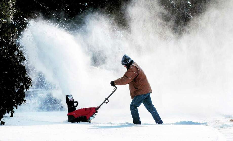(Arnold Gold ó New Haven Register)  Tom Neznek uses a snow blower to clear snow from the walkway at his house in Milford on 1/3/2014. Photo: Journal Register Co.
