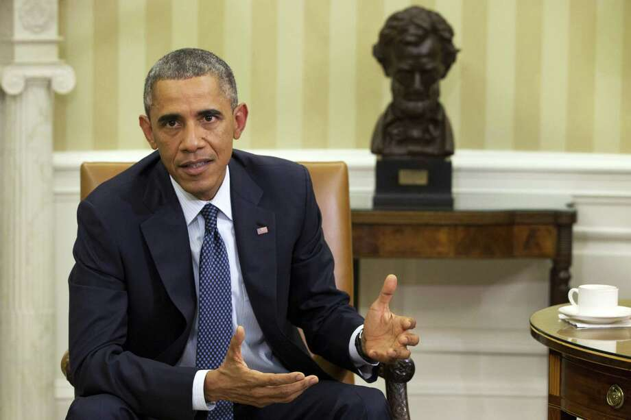 President Barack Obama speaks to the media about the governmentís Ebola response, in the Oval Office of the White House Thursday, Oct. 16, 2014, in Washington.  (AP Photo/Jacquelyn Martin) Photo: AP / AP