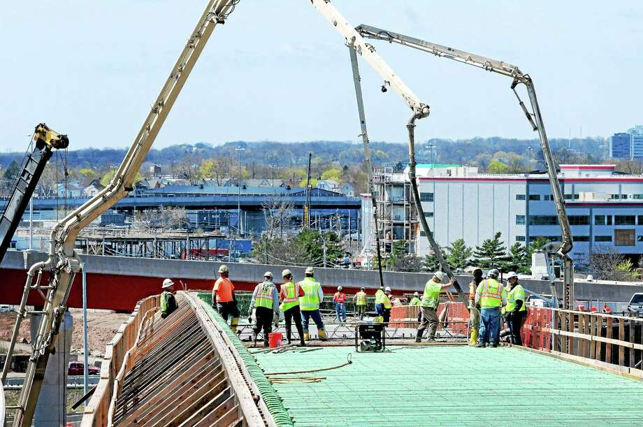 Concrete is poured on a section of highway connecting Interstate 95 south to Route 34 in New Haven Monday. Photo: Arnold Gold — New Haven Register