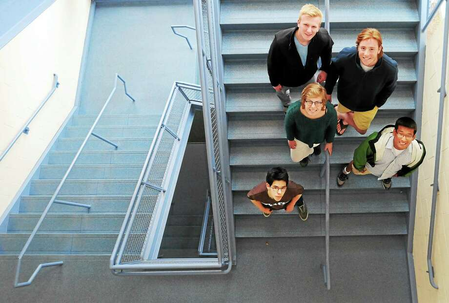 From bottom left to right, Austin Kane, Jen Ongley, Bill Brown, Mike Mrino and Doug Wu, Daniel Hand High School seniors of Madison, are working to push a bill for the state legislature that would ban smoking with young children in a car. Photo: (Peter Hvizdak - New Haven Register)   / ©Peter Hvizdak /  New Haven Register