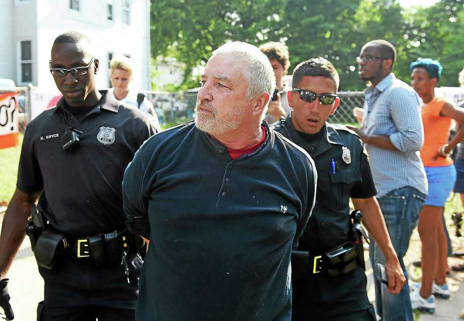 New Haven Police arrest Mark Colville of the Amistad Catholic Worker House at 634 Howard Avenue, a city owned property, a day after the group erected a homeless tent compound.  July 25, 2014. Photo: (New Haven Register File Photo)