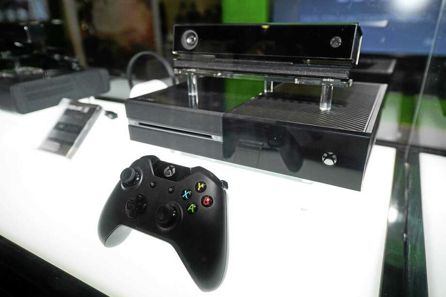 (Photo by Al Powers/Invision/AP, File)  In this Aug. 28, 2013 photo, the Microsoft Xbox One console is on display at the GameStop Expo in Las Vegas. Photo: Powers Imagery/Invision/AP / Invision