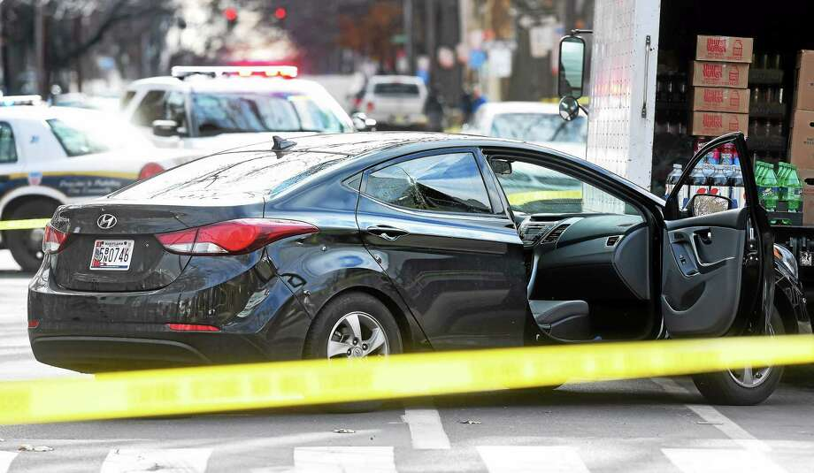A car involved in a shootout on Long Wharf Drive crashed into a truck on Howard Avenue at Second Street, police said. Photo: Arnold Gold — New Haven Register