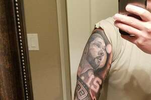 """Spurs fan Chuck Little spent six months and $2,400 on his tattoo, what he calls a """"snapshot of the Tim Duncan Era."""""""