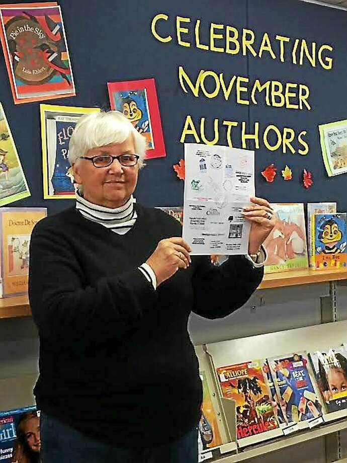 "Bonnie Osborne of Guilford visited 80 state libraries in September to win the Connecticut Library Association's ""Passport to Connecticut Libraries"" contest. Contributed photo Photo: Journal Register Co."
