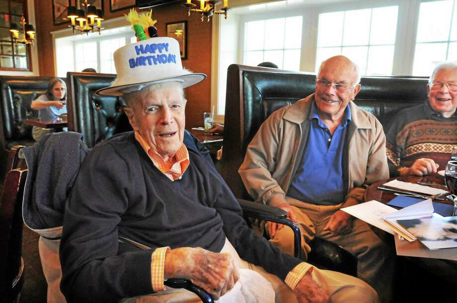 "A group of Madison men including Connie Millane and Malcolm MacGruer, at right, gather for lunch every Thursday at Donahue's Madison Beach Grille, and on Thursday celebrated Dominic ""Bud"" Griffin's 100th birthday, which is Saturday. One of their gifts to Griffin, left, was the silly hat. Photo: Mara Lavitt — New Haven Register     / Mara Lavitt"
