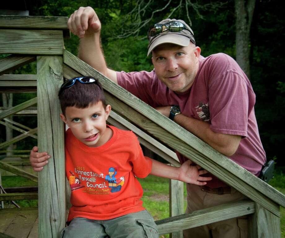 (Melanie Stengel - Register)   Nicholas Grant, 7 (L), of North Branford, with his father Ron Grant 6/20. Nicholas has congenital facial paralysis and will be undergoing surgery  to correct it . Photo: Journal Register Co.