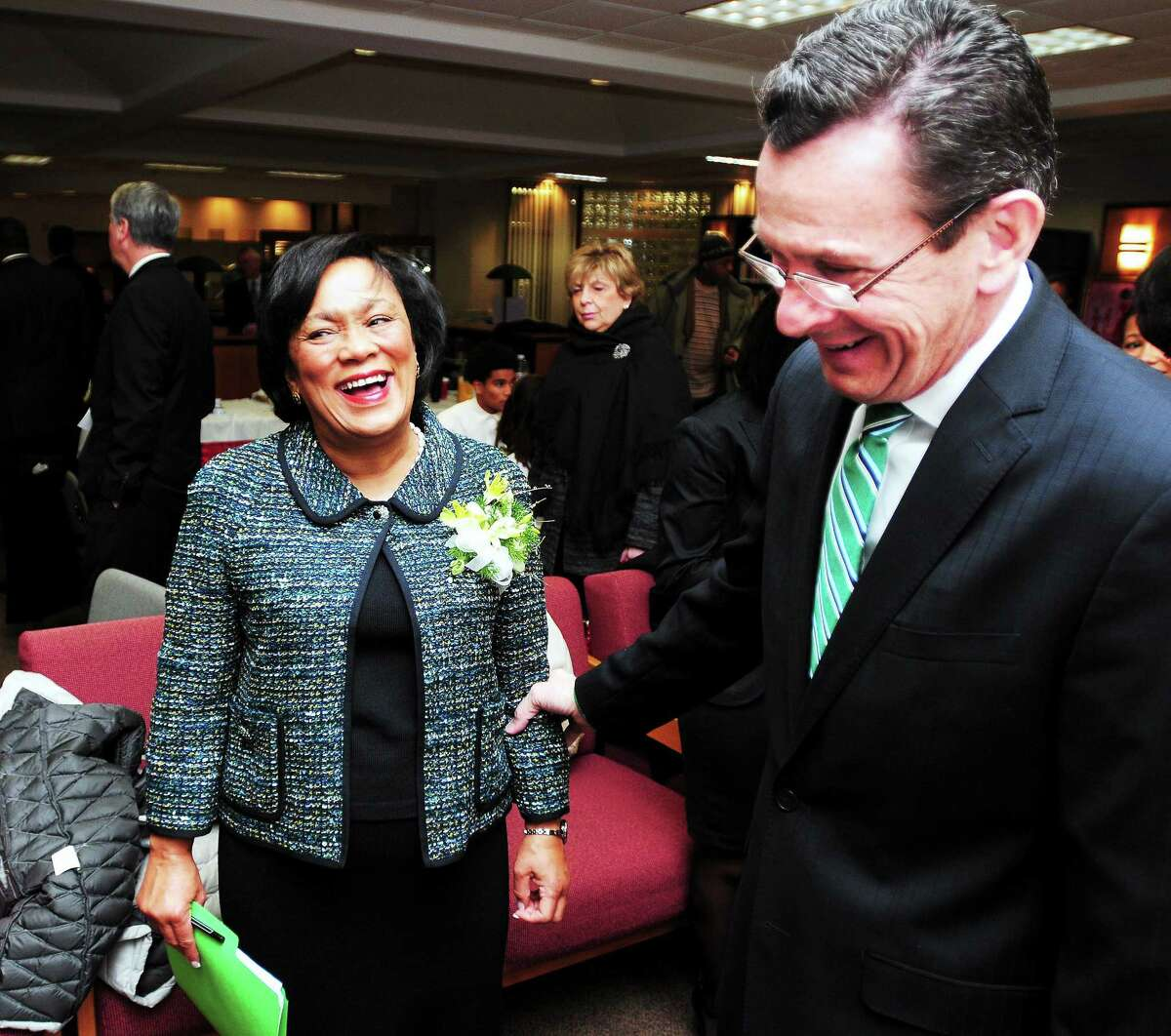 New Haven Mayor Toni N. Harp, left, is greeted by Gov. Dannel P. Malloy before inauguration ceremonies at Hill Regional Career High School in New Haven Wednesday.