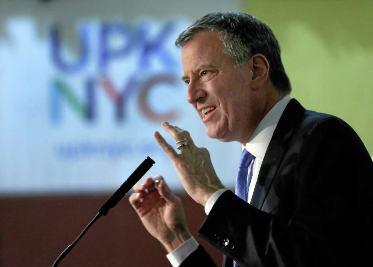 In this Dec. 19 photo, New York Mayor-elect Bill de Blasio delivers his remarks at the Friends of Crown Heights Educational Center in the Crown Heights section of the Brooklyn borough of New York.