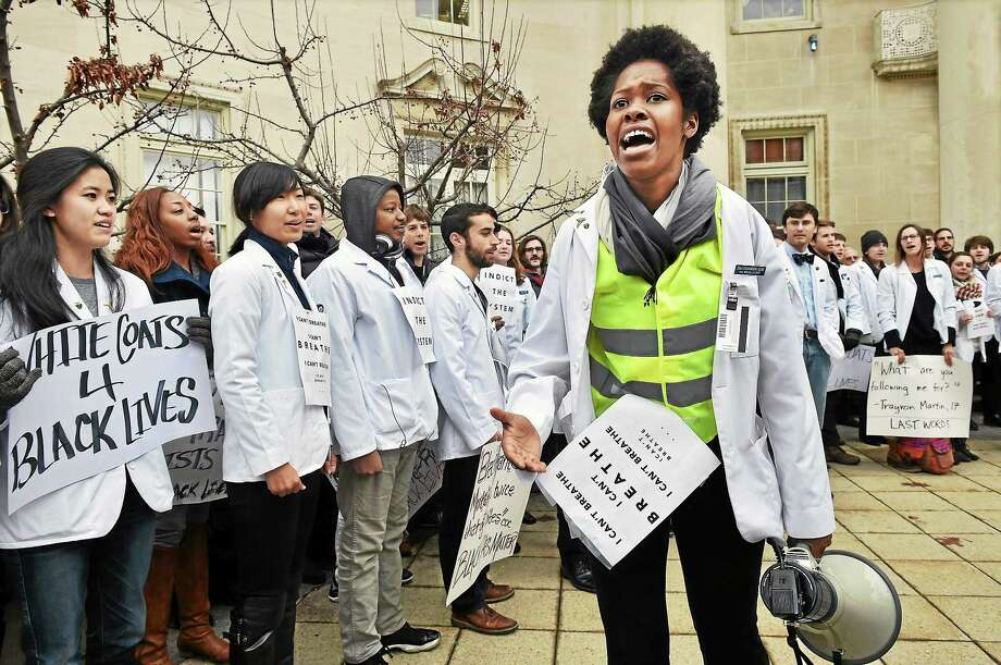 "Yale medical student Zola Chihombori Quao leads medical students in a chant, ""black lives matter"" during a White Coat Die-In at Yale School of Medicine at 333 Cedar Street in New Haven Wednesday afternoon, December 10. 2014. The demonstration is part of the National White Coat Die-In happening in medical schools across the country in response to the death of Michael Brown, an unarmed black teenager who was shot and killed on Aug. 9, by Darren Wilson, a white police officer, in Ferguson, Mo . Photo: (Catherine Avalone - New Haven Register)    / New Haven RegisterThe Middletown Press"