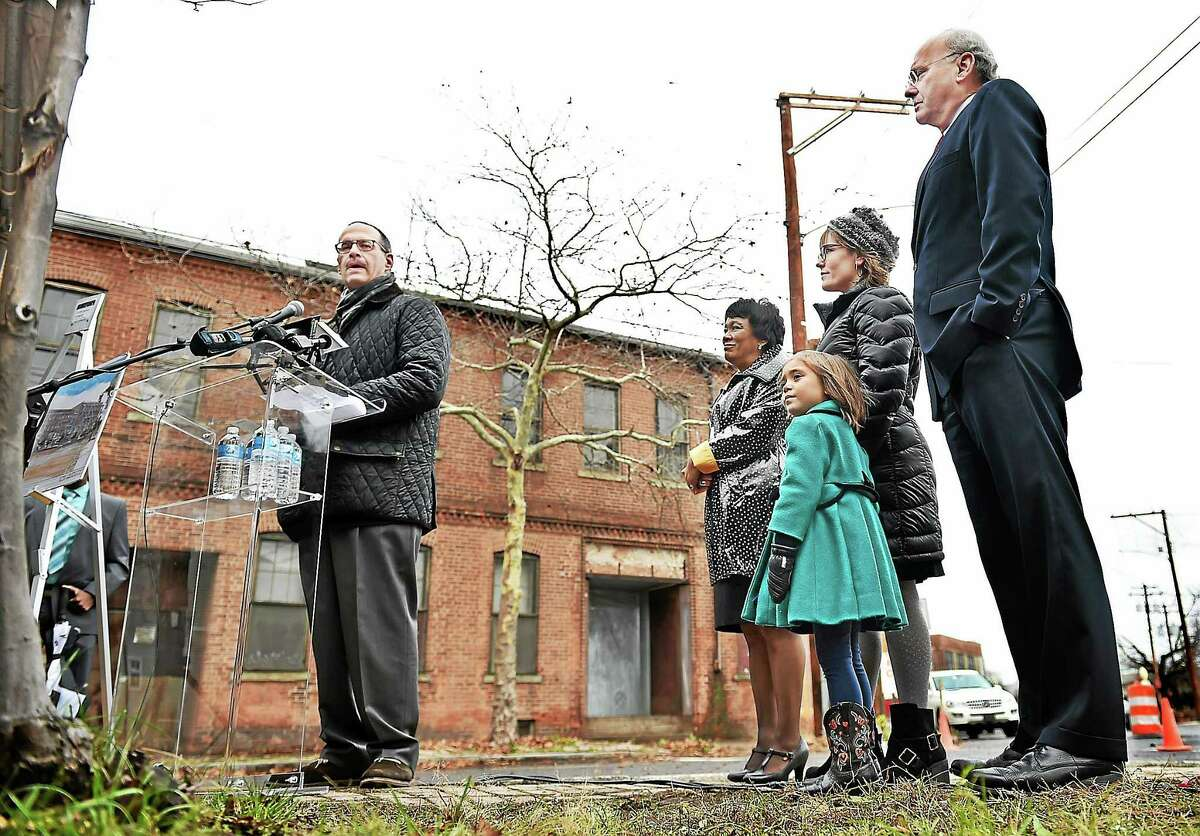 Developer Andrew Montelli, of Post Road Residentials Inc. speaks at the ground breaking of the State Street Lofts Project, a 3.1-acre industrial site in the Orange Street Historic District in the East Rock neighborhood in New Haven Wednesday, December 10. 2014. The existing brick building will include 4,000 square feet of retail space on the ground floor with three residential units above and 235 market-rate apartments. At right, Mayor Toni Harp, Alder Jessica Holmes and her daughter Evie, and Economic Development Administrator Matthew Nemerson.