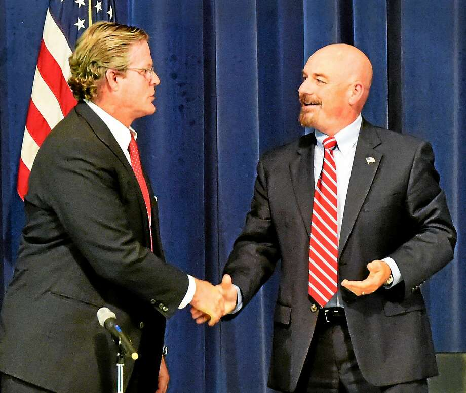 Democrat Ted Kennedy Jr. of Branford, left, and Republican Bruce Wilson Jr. of Madison, right, candidates for the 12th Senate District, shake hands after their debate Tuesday at Guilford High School. Photo: Peter Hvizdak — New Haven Register     / ©2014 Peter Hvizdak