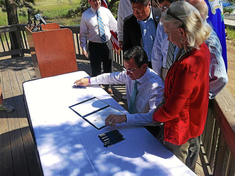 Gov. Dannel Malloy Monday picked East Haven's Farm River State Park as the backdrop for a ceremonial signing of anti-fracking waste legislation. Photo: Evan Lips — New Haven Register