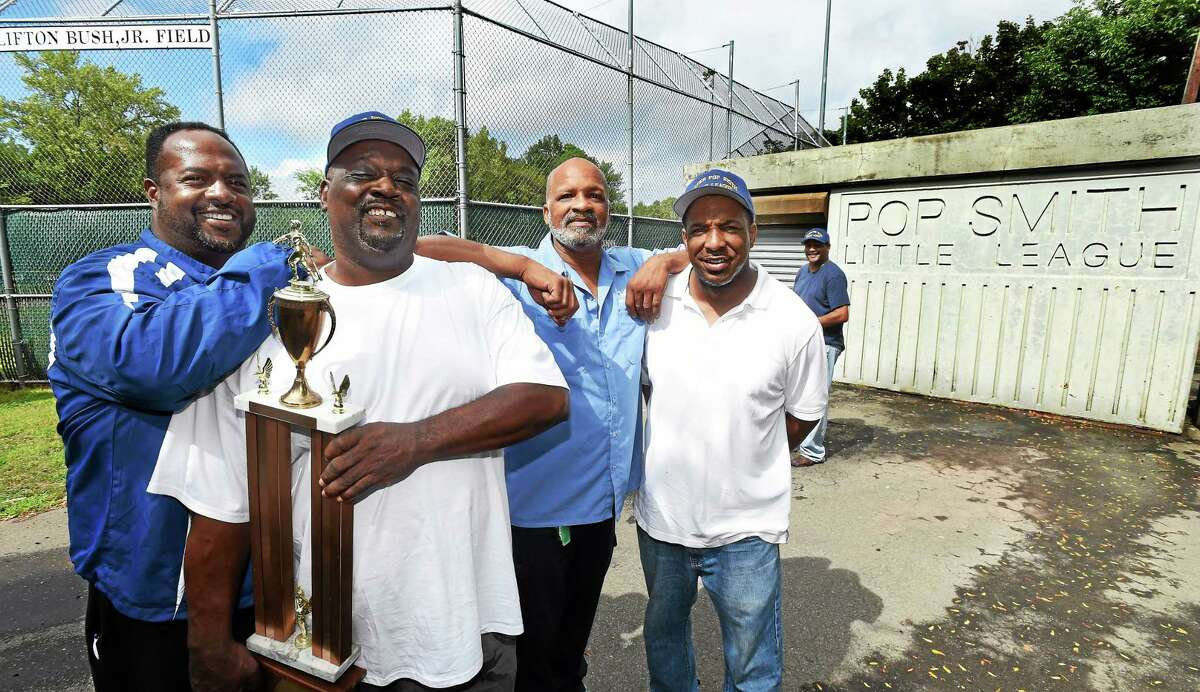 Members of the 1974 Pop Smith team that advanced to the Little League World Series gather at the field in New Haven. From left are Garland Patton, David Crudup, Junior Harding and Glen McNeil. Pop Smith league president Lynair Walker of New Haven is in the background.