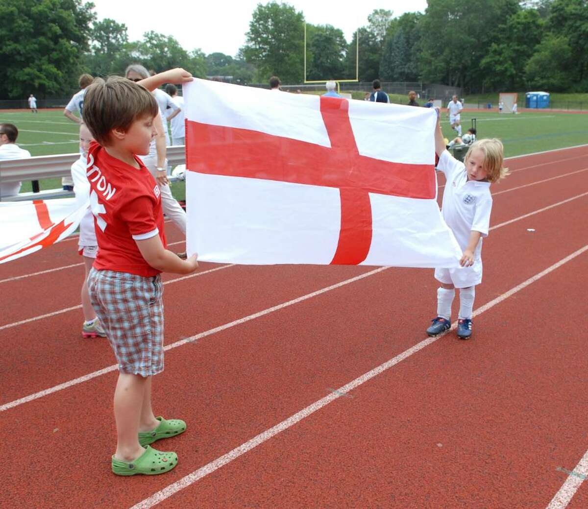 Anglophiles Alfred Otton, 8, left, and friend Freddie Brogden, 5, both of Greenwich, raise the flag of England during a friendly pick-up soccer match at Greenwich High School between teams of Yanks and Brits, Saturday, June 12, 2010.