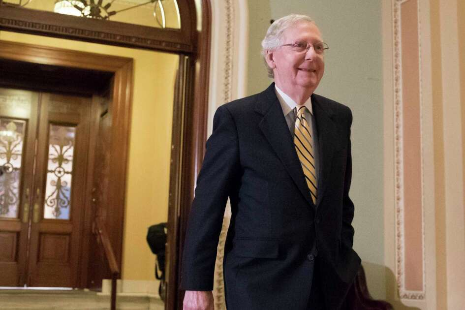 Senate Majority Leader Mitch McConnell, R-Ky. walks from the Senate Chamber on Capitol Hill in Washington, Tuesday, July 25, 2017, as he steers the Senate toward a crucial vote on the Republican health care bill.