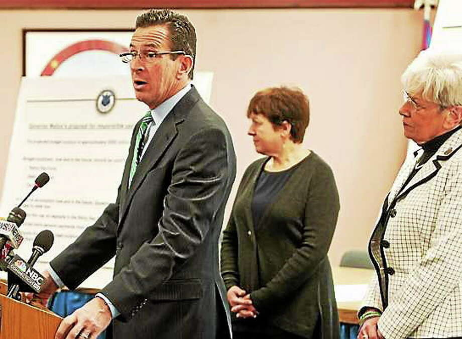 In this Jan. 30 photo, Gov. Dannel P. Malloy, with Derby Mayor Anita Duggato, center, and Lt. Gov. Nancy Wyman, right, announces a three-point plan for the budget surplus during a press conference at Derby City Hall. Photo: Peter Hvizdak — New Haven Register