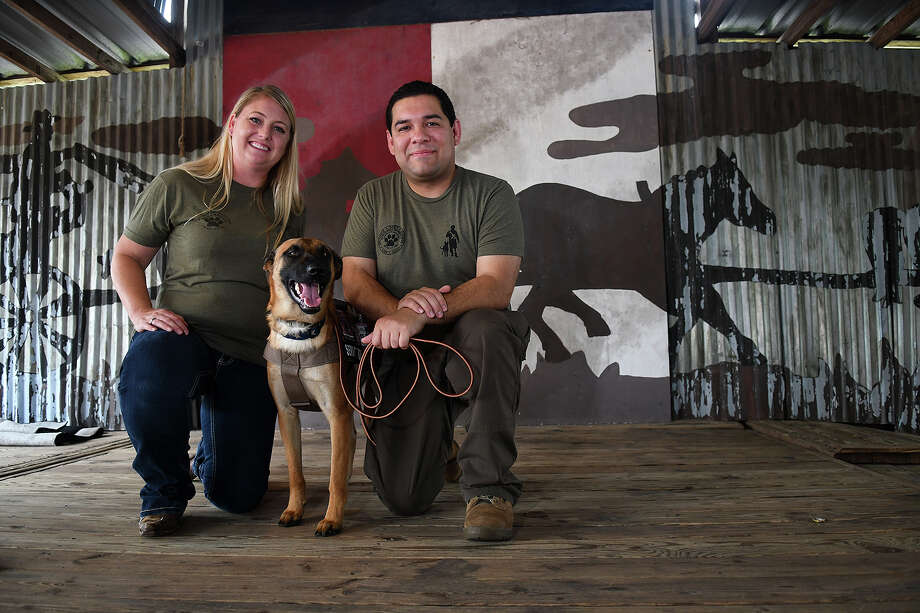 Veteran Bonds With New Service Pup Community Over Bbq In