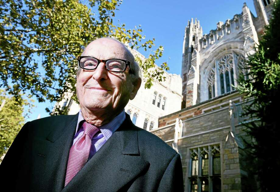 Harold Kent in front of the Yale Law School, where he is auditing courses. Photo: Arnold Gold — New Haven Register