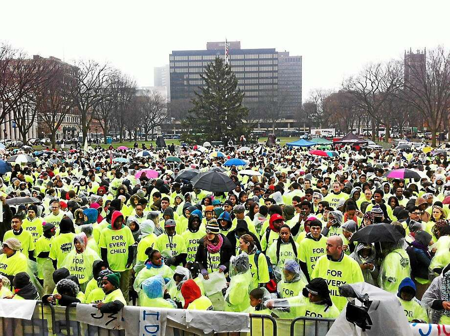 PETER HVIZDAK — NEW HAVEN REGISTER  Thousands participate in an education rally Wednesday on the New Haven Green. Photo: Journal Register Co.