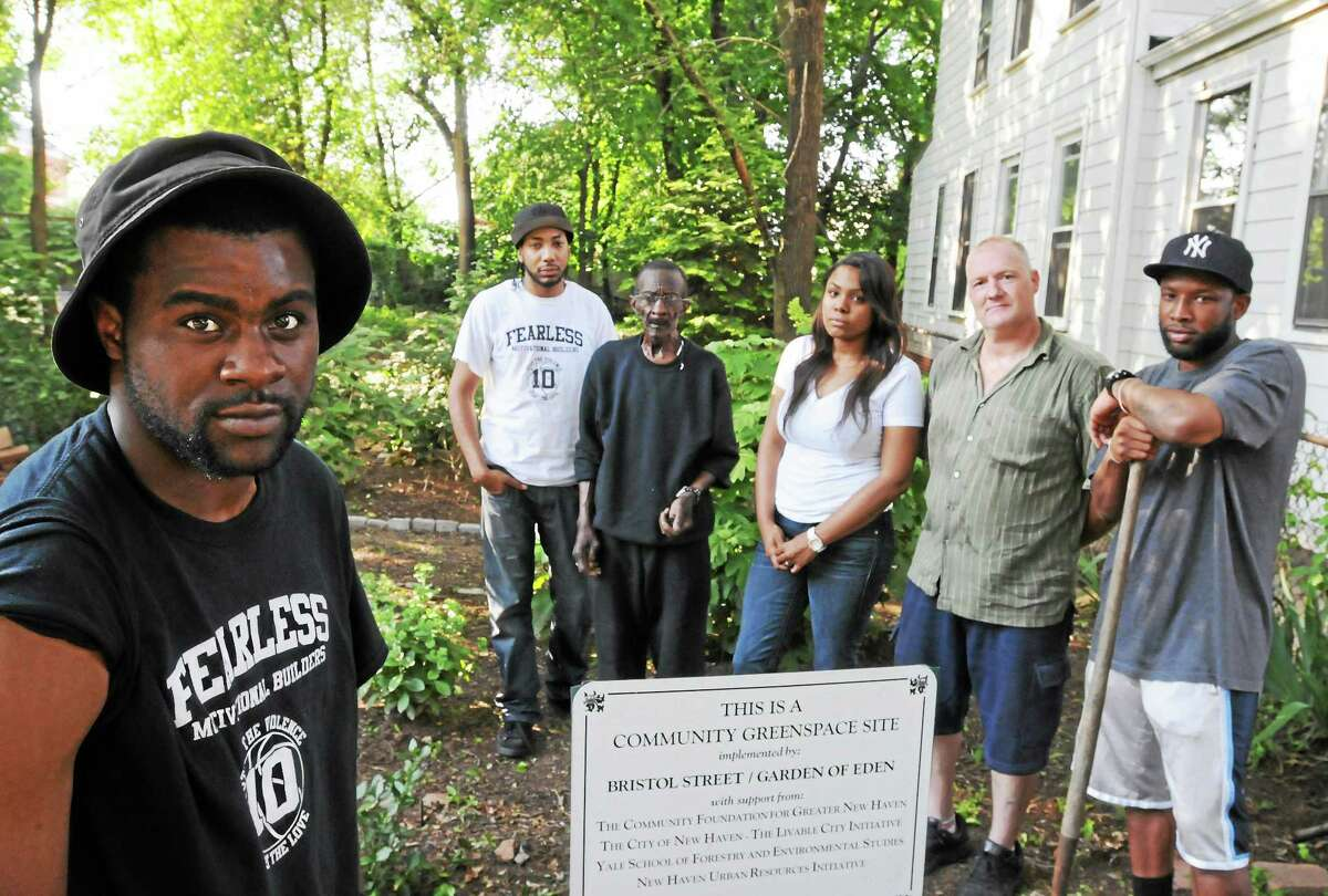From left, De'Ari Allick with some of the Fearless Motivation Builder group, Kiwa Bolden, Isiah Mack, Daia Allick, Louis Bernardo and Matt Smith at the community garden area on Bristol Street in New Haven.