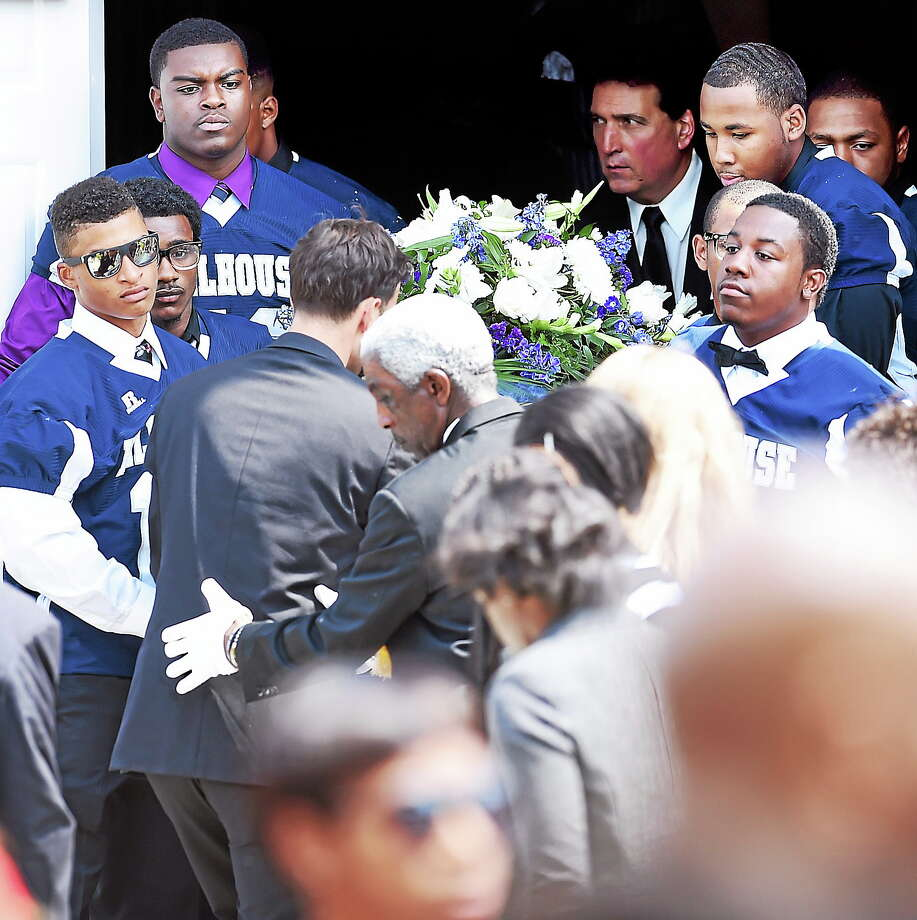 Members of the Hillhouse High School football team carry the casket of Jacob Craggett out of the Christian Tabernacle Baptist Church in Hamden on August 16, 2014. Photo: (Arnold Gold — New Haven Register)