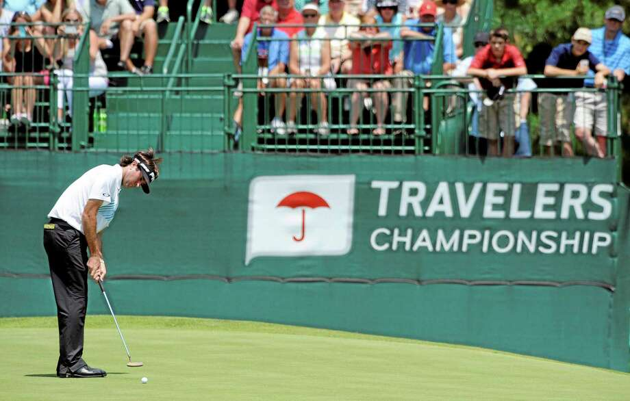 Bubba Watson watches his putt on the eighth green during the second round of the Travelers Championship golf tournament in Cromwell, Conn., Friday, June 21, 2013. Watson shot a 3-under par 67 in his round, to go 10-under par for the tournament. (AP Photo/Fred Beckham) Photo: AP / FR153656 AP
