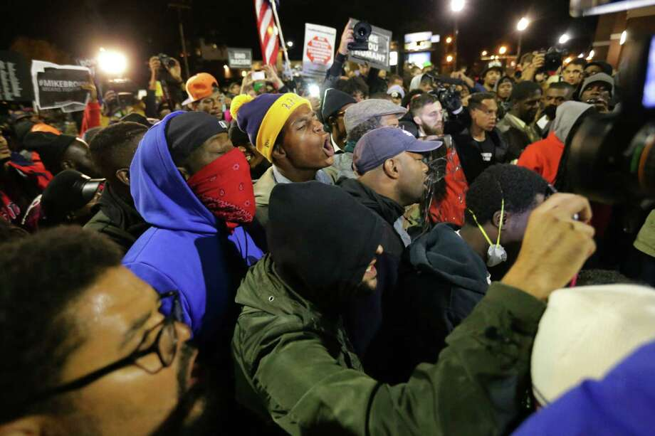 Demonstrators rally in Ferguson on Friday, Oct. 10, 2014, as part of a weekend of planned protests called Ferguson October.  (AP Photo/St. Louis Post-Dispatch, Robert Cohen) Photo: AP / St. Louis Post-Dispatch