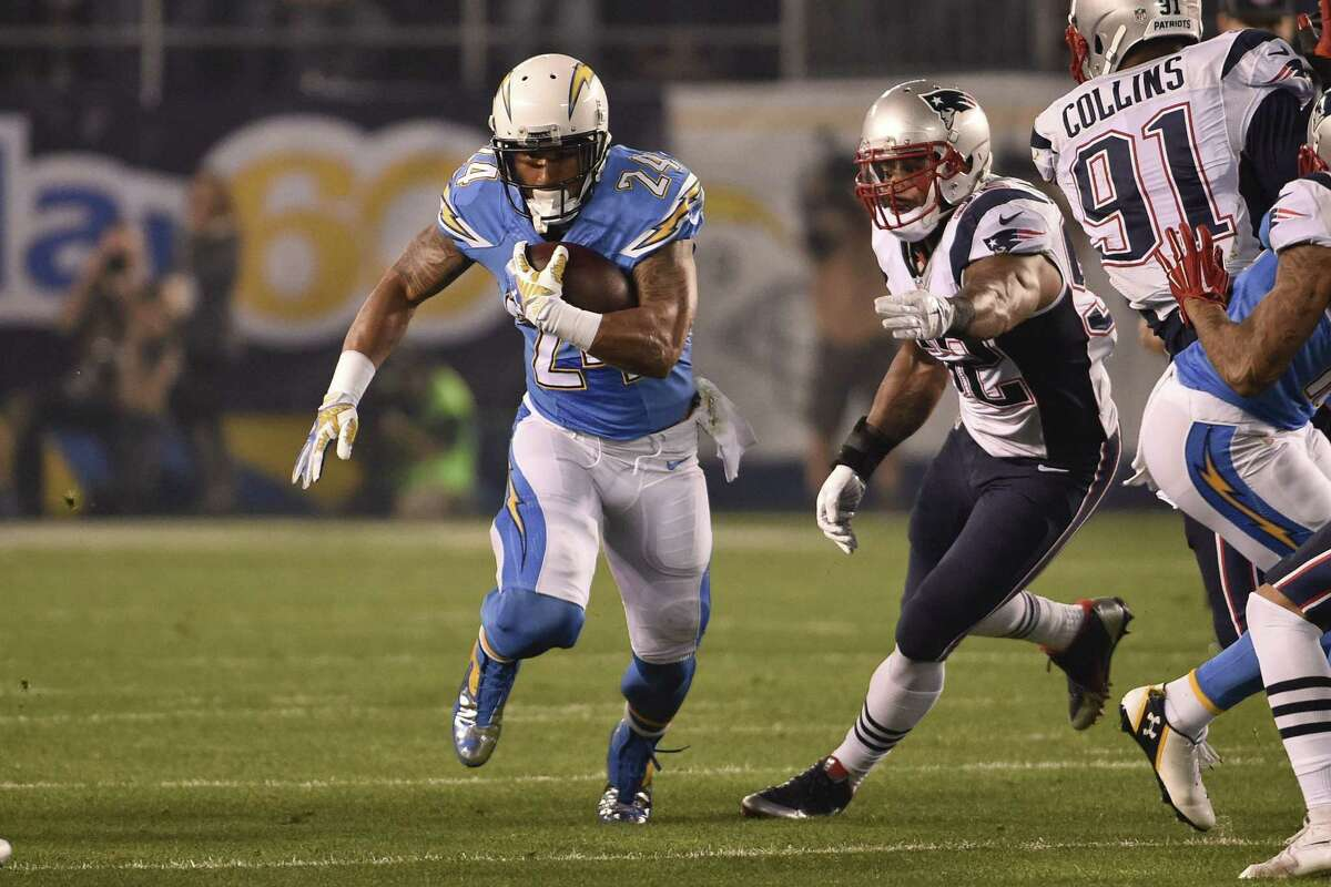 San Diego Chargers running back Ryan Mathews runs up the middle against the New England Patriots during the first half in an NFL football game Sunday, Dec. 7, 2014, in San Diego. (AP Photo/Denis Poroy)