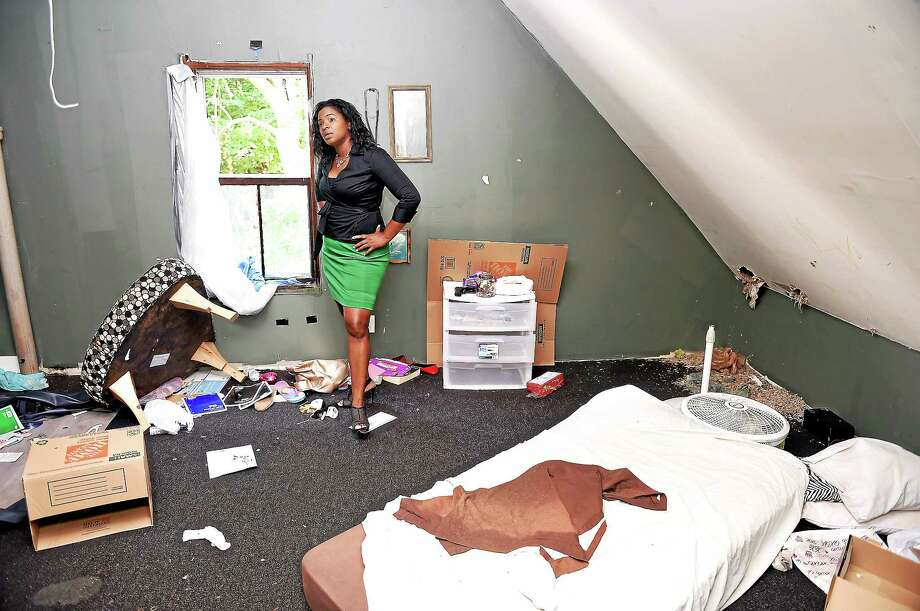 Roberta Hoskie, owner of Outreach Realty, looks over the third floor of a distressed property she purchased at 287 Division St. in New Haven on August 7, 2014. Photo: (Arnold Gold — New Haven Register)