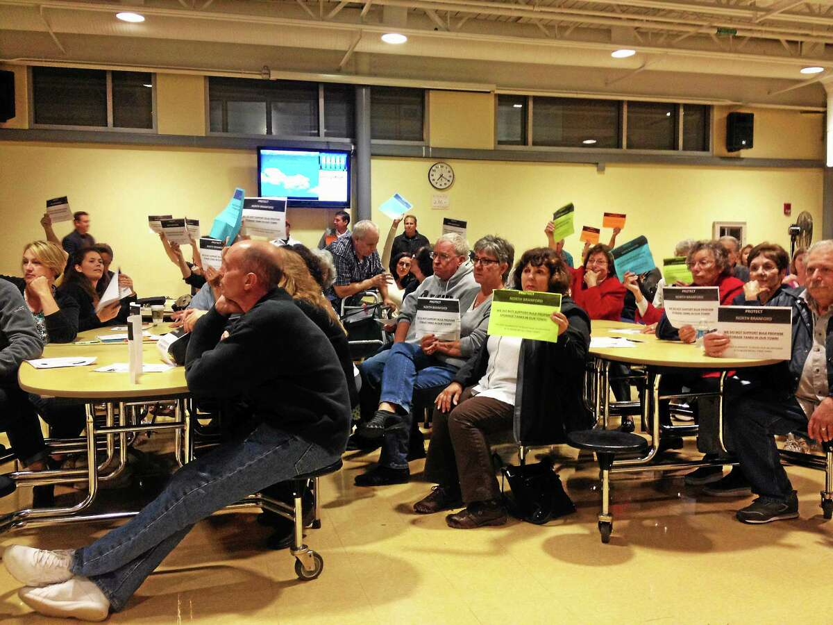 North Branford residents hold up signs in opposition of the proposed propane facility on Ciro Road. J.J. Sullivan Fuel Oil has proposed housing two 30,000-gallon propane tanks at the property. Kristin Stoller - New Haven Register
