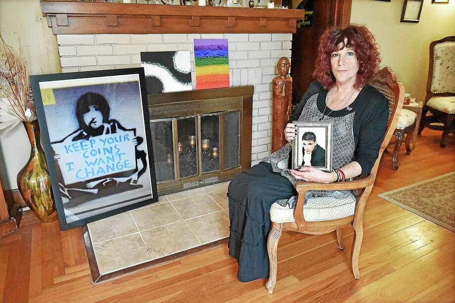 (Catherine Avalone - New Haven Register)  East Haven resident Judy Murray holds a high school portrait of her son Dan Kelson who committed suicide in May at the age of 23. Murray is the founder of D.A.N. or Don't Accept No and is holding a mental health awareness and healing forum at 6:30 at East Haven High School on Thursday, on October 23, 2014. For more information, visit www.dontacceptno.org. Photo: Journal Register Co. / New Haven RegisterThe Middletown Press