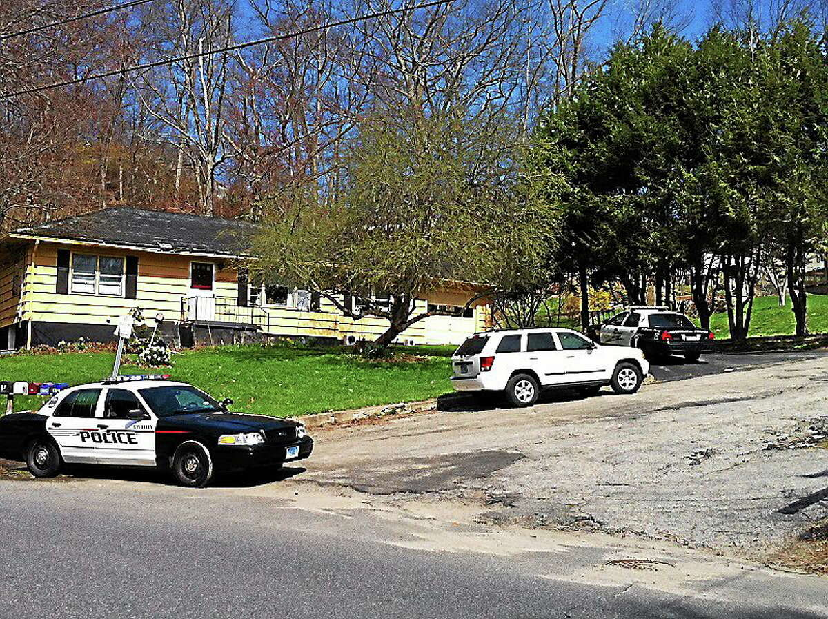 Police at the scene of a shooting Sunday on Woodbridge Avenue in Ansonia.