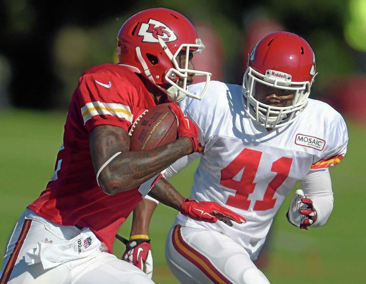 Kansas City Chiefs receiver Dwayne Bowe (82) tries to elude Malcolm Bronson (41) during training camp Tuesday in St. Joseph. Mo.