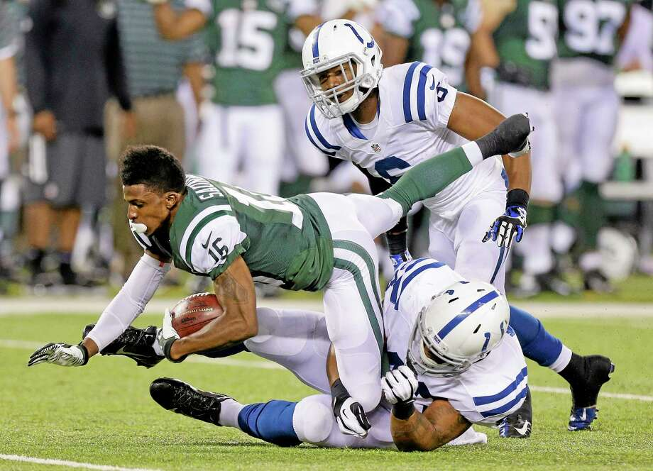 New York Jets wide receiver Jalen Saunders (16) is tackled by the Indianapolis Colts' Cameron White (43) and cornerback Loucheiz Purifoy (6) after losing his helmet on a kickoff return in the fourth quarter of a preseason game Aug. 7 in East Rutherford, N.J. Photo: Frank Franklin II — The Associated Press   / AP