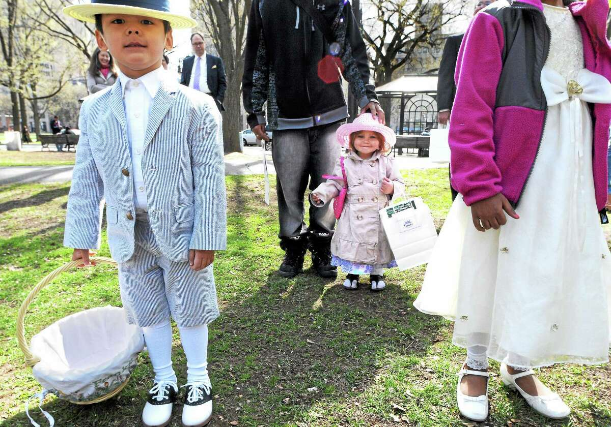 (Mara Lavitt ó New Haven Register) April 20, 2014 New Haven New Haven's Trinity Church on the Green held its fifth annual Easter Egg Hunt on the Upper Green in New Haven. Francis Segger, age 4 of Madison, and Jasmyne Sky Mendez age 2 of New Haven await the start of the hunt. mlavitt@newhavenregister.com