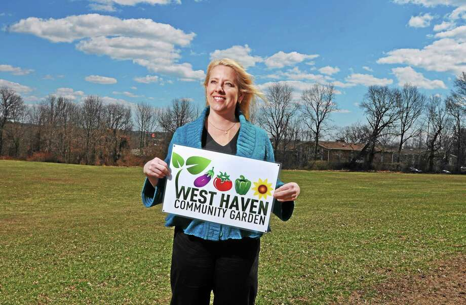 (Peter Casolino-New Haven Register)  Marilyn Wilkes of West Haven has recently helped organize a community garden to be built in the property at Anna V. Molloy School, shown behind her.  4/9/14 Photo: Journal Register Co.