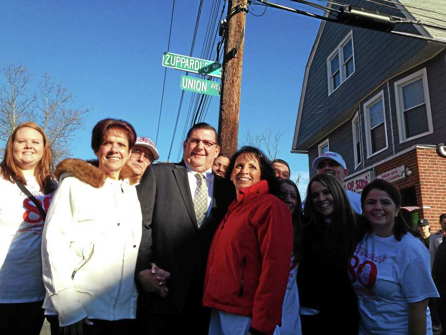 """West Haven Mayor Ed O'Brien poses with Zuppardi's Apizza owners Cheryl Zuppardi Pearce and Lori Zuppardi after unveiling the """"Zuppardi Way"""" sign at the 80th Anniversary celebration for Zuppardi's Apizza in West Haven on Sunday, Dec. 7, 2014. Photo: Mark Zaretsky — New Haven Register"""