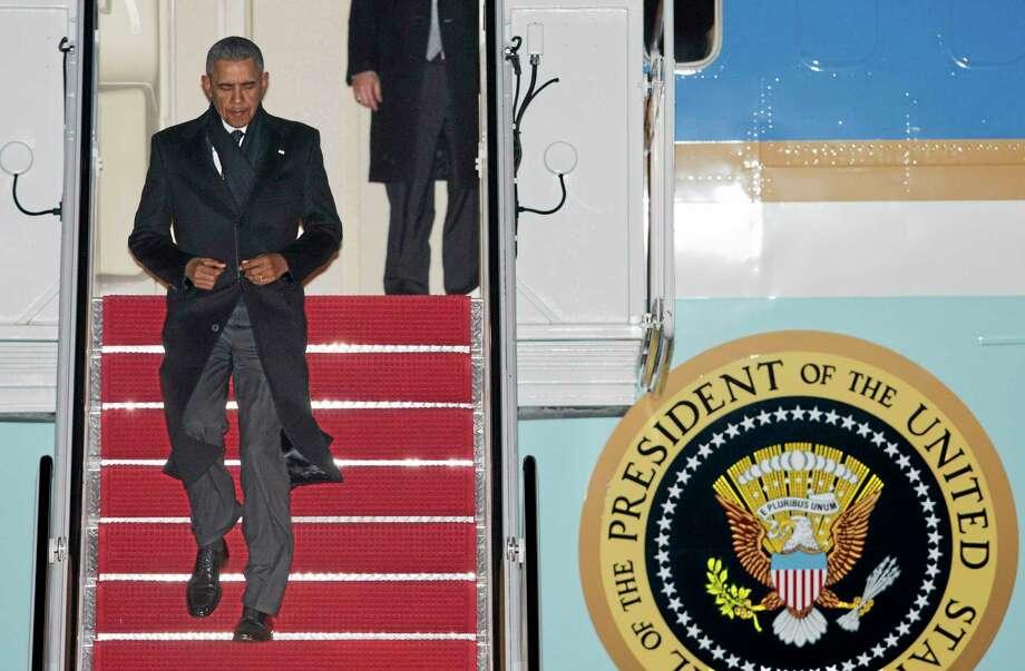 President Barack Obama, arrives Andrews Air Force Base, Md., from a trip to St. Paul, Minn., Wednesday, Feb. 26,  2014.   (AP Photo/Manuel Balce Ceneta) Photo: AP / AP