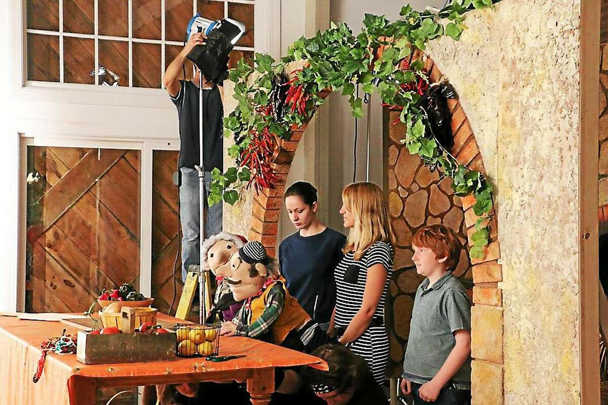 La Befana, Pasquale & young friend Liev Evans behind the scenes shooting a video scene. Contributed photo