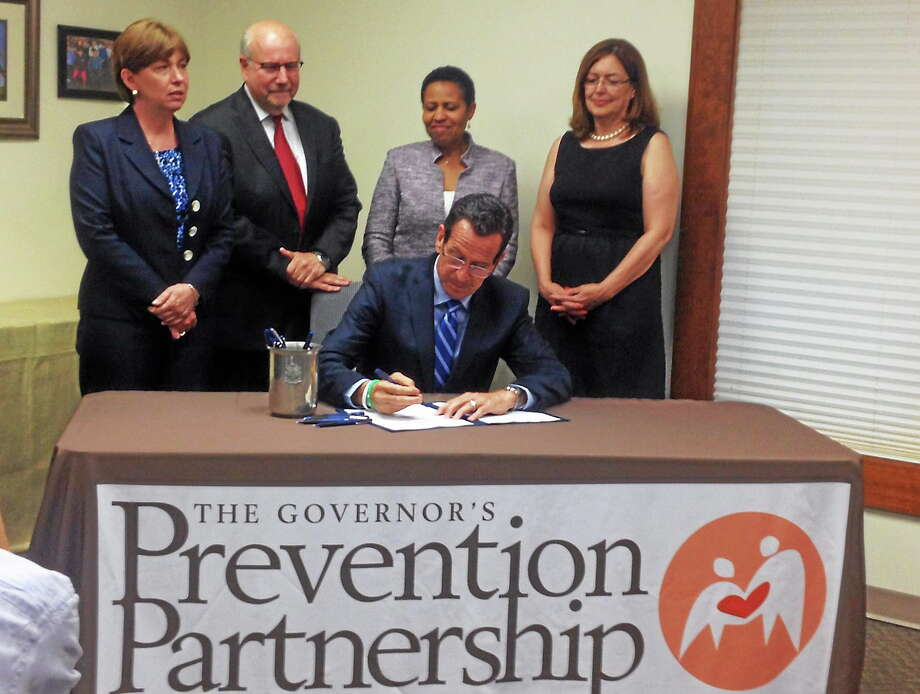 Gov. Dannel P. Malloy held a bill signing ceremony in Wethersfield Tuesday, where he signed legislation that grants civil and criminal liability protection to a bystander who administers Naloxone Hydrochloride (known as Narcan) in good faith to someone who has overdosed. Photo: Contributed Photo — Office Of Gov. Malloy