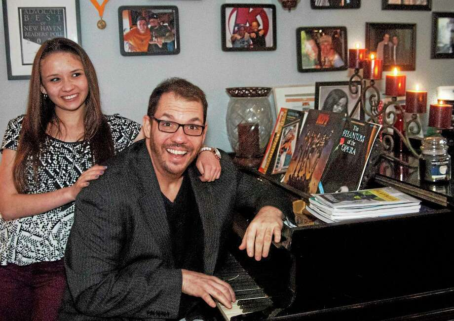 Jillian Maze (L) and her dad, Michael Maze, of North Haven in their home 4/15. Michael Maze, hasrecovered from cancer surgery, CHEMO therapy and radiation treatmets. He is helping to spread the word about the Yale-New Haven, Smilow Cancer Hospital, and Yale Cancer Center free public screening for head and neck cancers. Photo: (Melanie Stengel - Register)