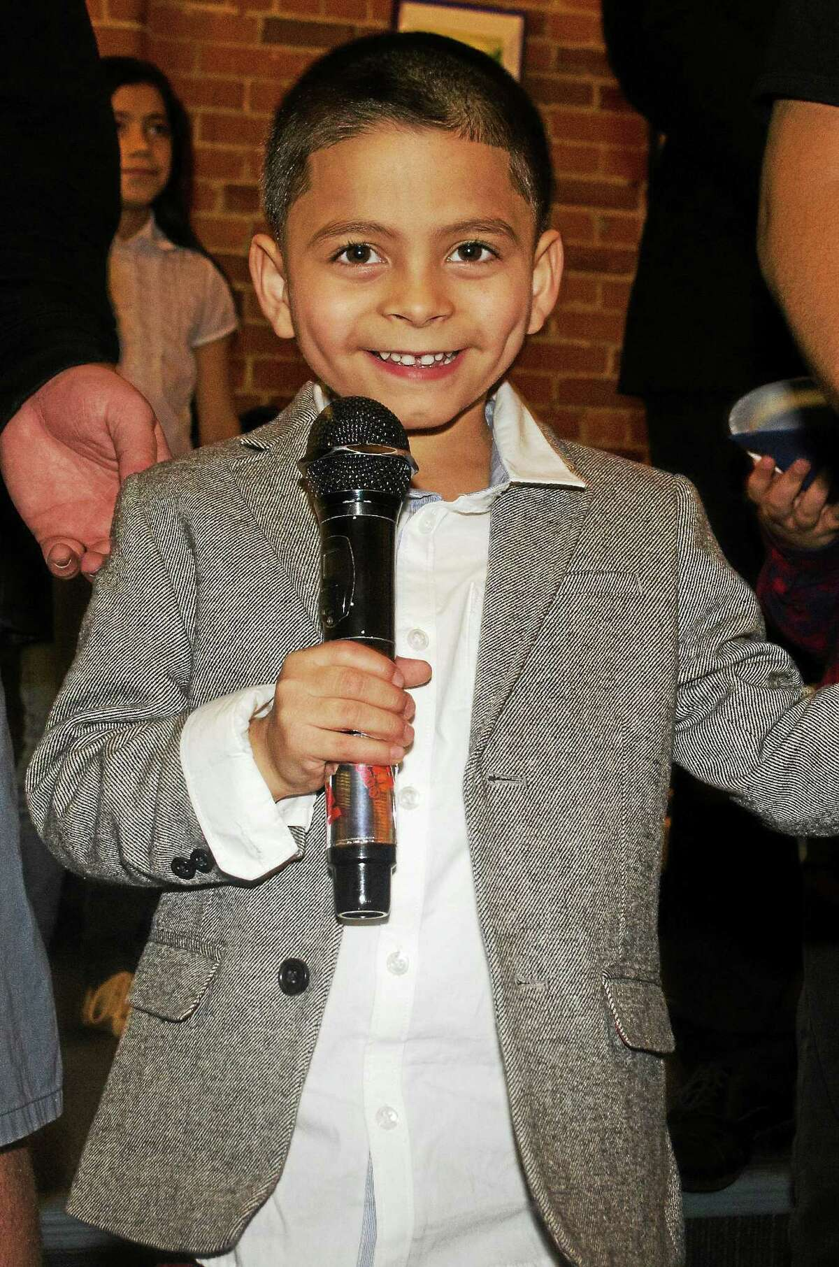 Adrian Laureano at the mic Sunday at Karaoke Heroes in New Haven.