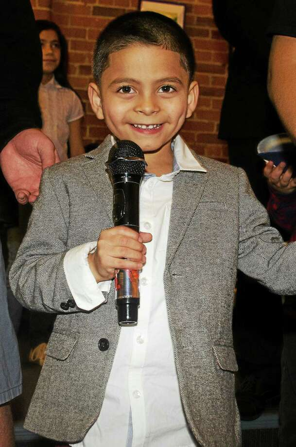 Adrian Laureano at the mic Sunday at Karaoke Heroes in New Haven. Photo: Samantha Mathewson — For The Register