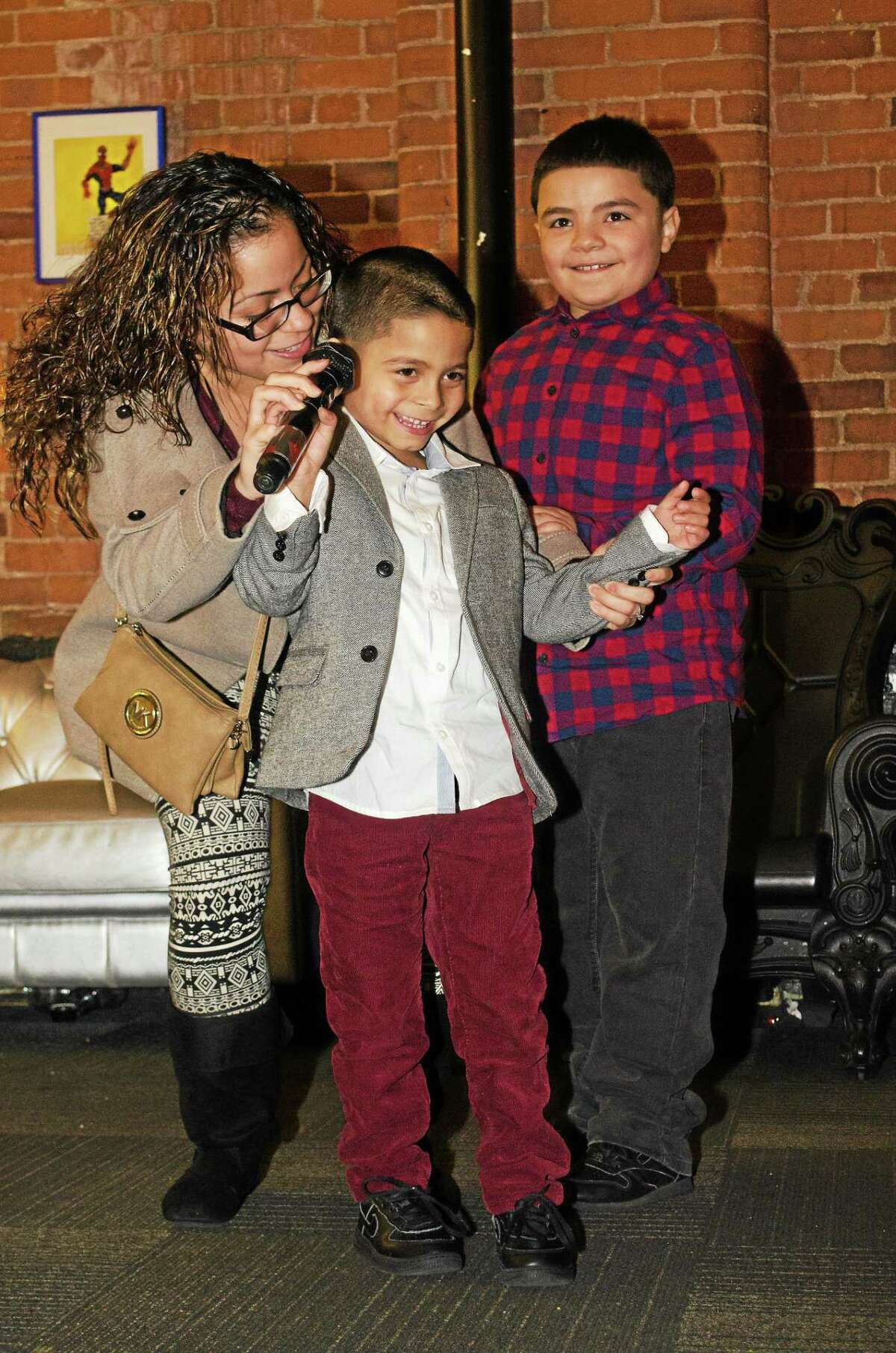 Adrian Laureano accompanied by his mother, Jasmine Gonzalez, and his brother, Josue Alvarez.